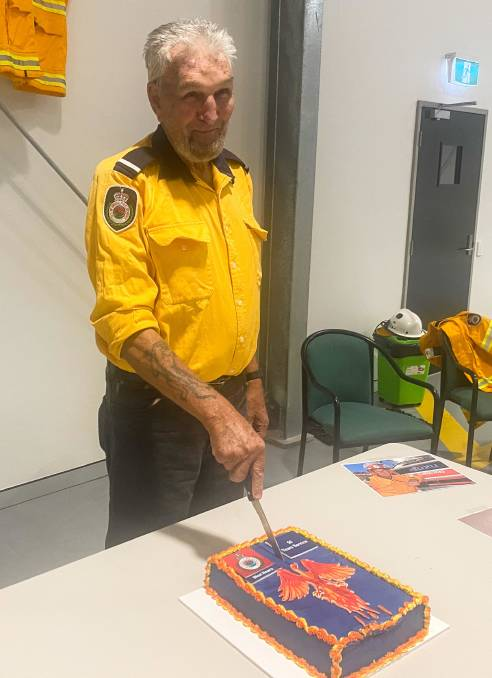 Exceptional service: Victor Judson cuts a cake to celebrate 52 years of service with the RFS.