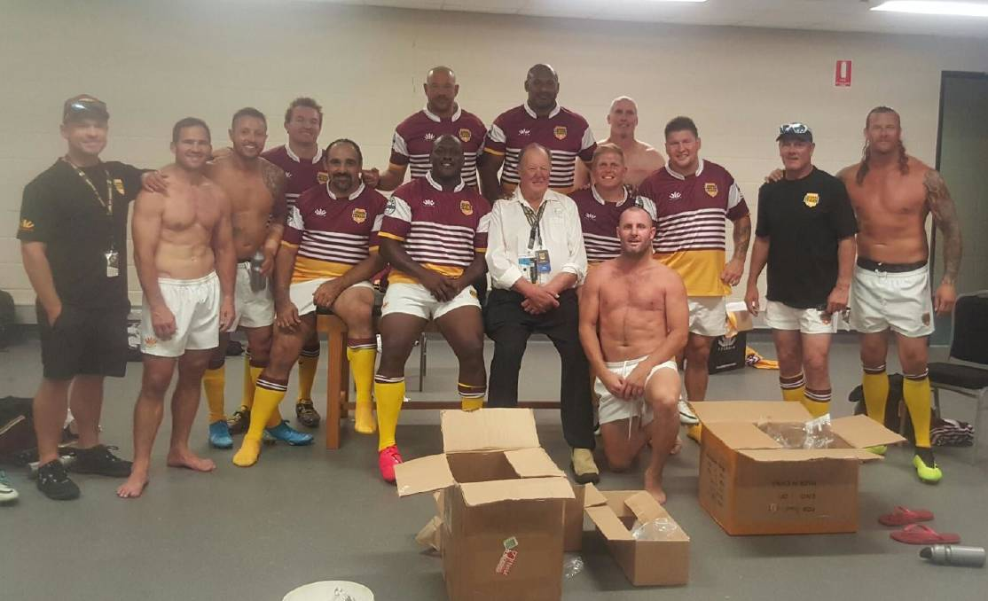 Wayne Bennett (white shirt) and the Brisbane Broncos Legends of League side, including Ashton Sims (far right). Photo: SUPPLIED