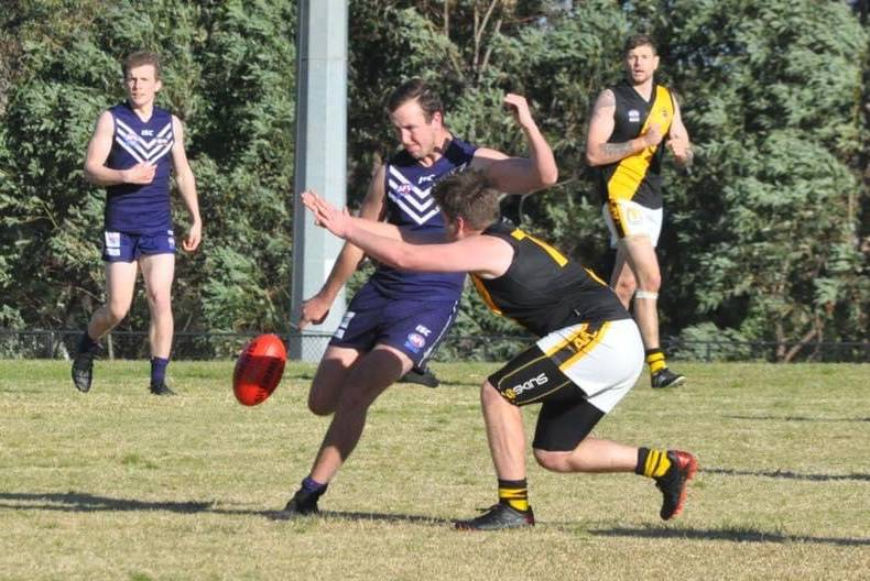 Ulladulla Dockers' Harrison Donohue sets himself for a kick against the Bomaderry Tigers this season. Photo: Kimberley Peat