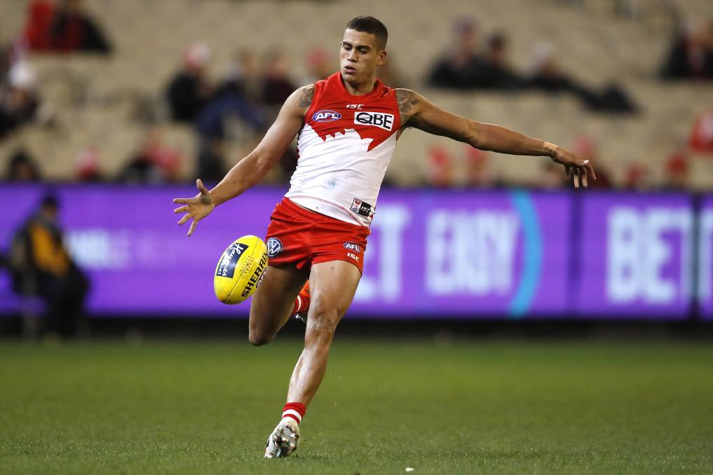AFL South Coast product James Bell looks to kick the ball down field during a Swans game last year. Photo: AFL Photos