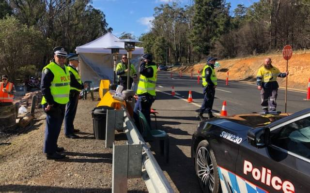 IMPORTANT ROLE: Officers from across the South Coast Police District have joined navy and army personnel from the Australian Defence Force along with staff for Transport for NSW in manning a checkpoint at Timbillica. Photo: Supplied