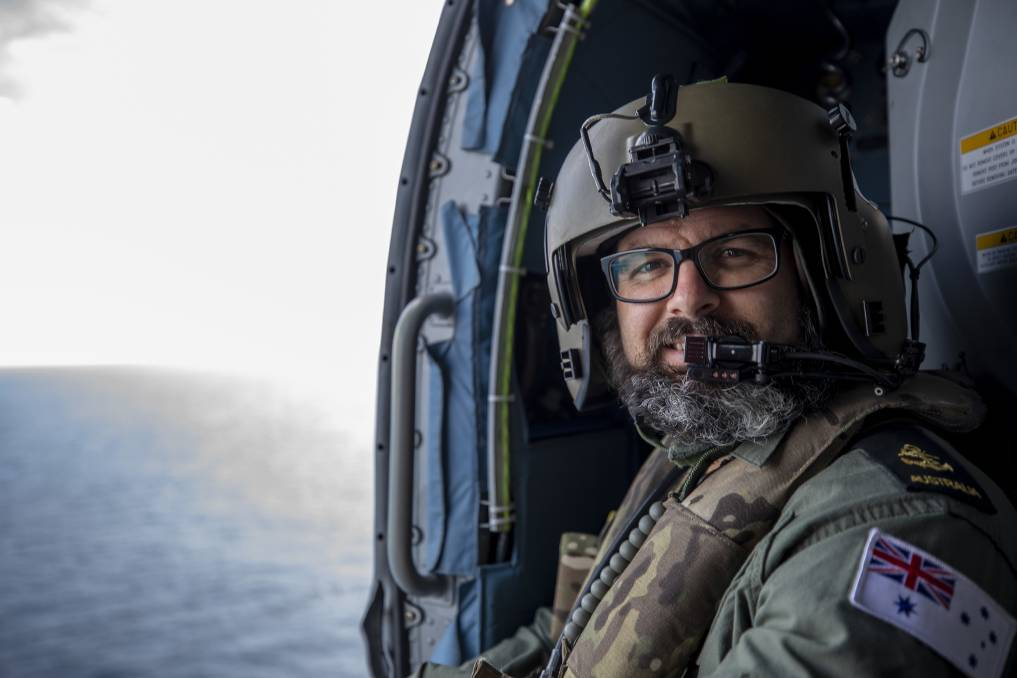 MILESTONE: Leading Seaman Aircrewman Curtis Maxwell aboard MH-60R Seahawk as he completes his 1000th hour of flight time on HMAS Hobart while deployed at sea. Photo: Christopher Szumlanski