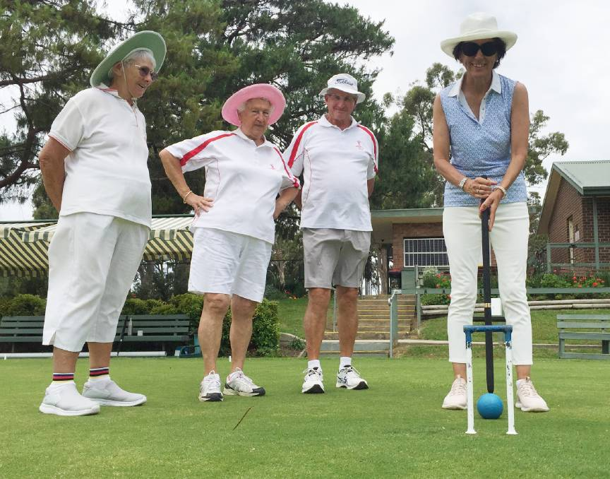 GREAT DAY: Nowra Croquet Club members (from left) captain Margaret Sawers, Marie McLean and Doug Cornish get the good oil from former world number one player Alison Sharpe.