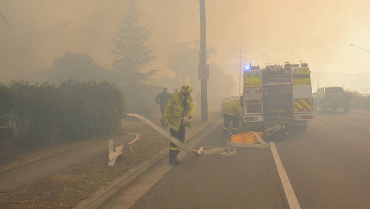 Fire crews prepare to battle last Wednesday's fire at Bomaderry. Photo: Robert Crawford