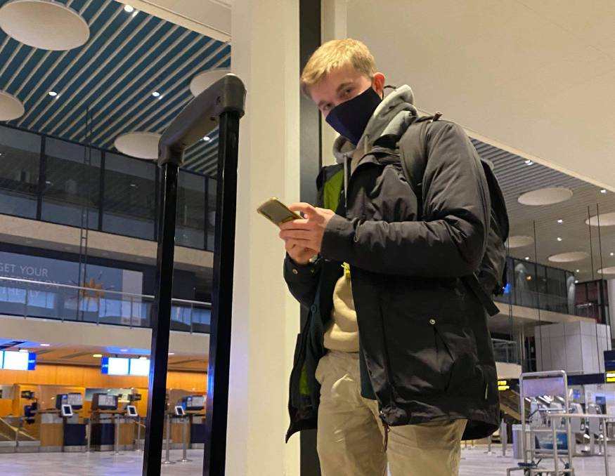 CHECKED IN: Shoalhaven's Saxon Perry waiting to board his plane home in the Denmark capital Copenhagen.