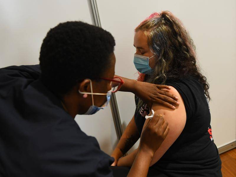The federal government will not set a new timeframe for the rollout of COVID-19 vaccinations.