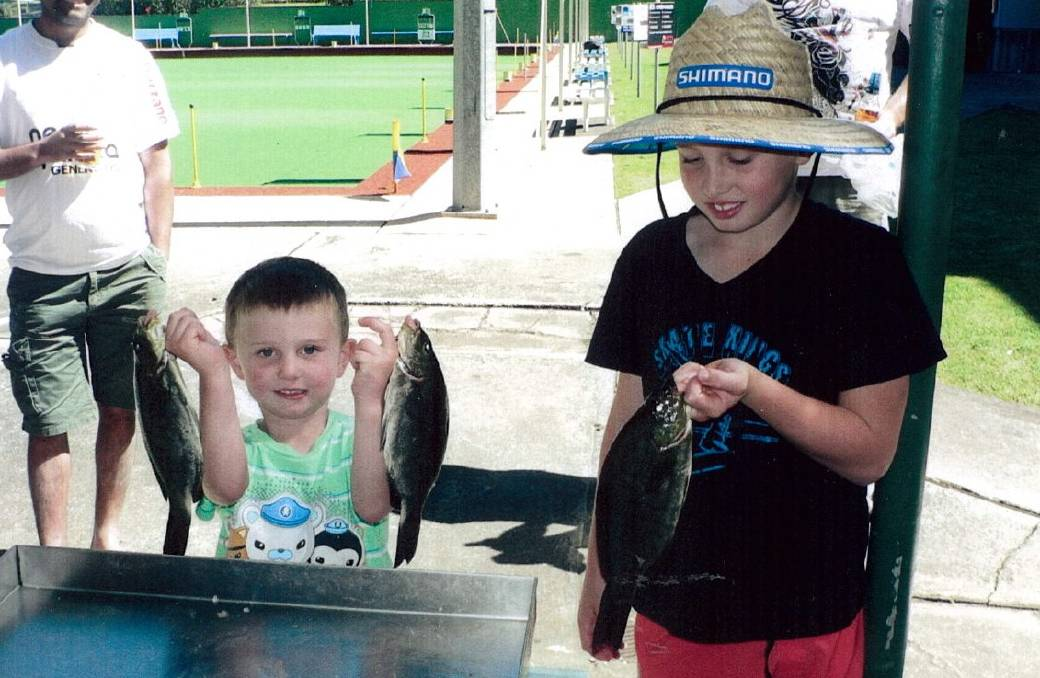 START YOUNG: Mollymook Bowling Club Fishing Club's Lucas Nelson and his big brother Thomas with their catch of luderick.